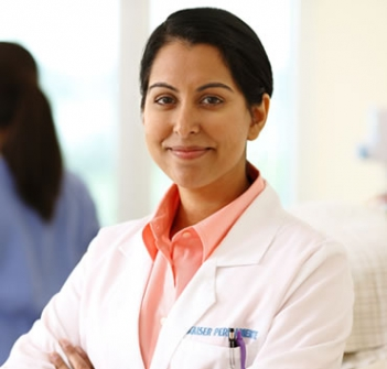 Woman Kaiser Permanente Doctor smiling with arms crossed