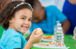 child eating and smiling
