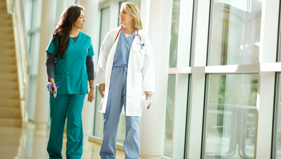 nurse and doctor walking