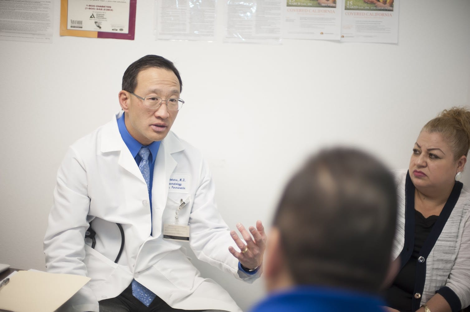Dr. Michael Takehara talking with patients