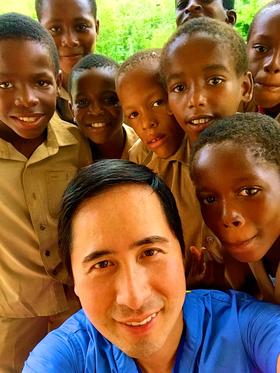 Dr. Cheng gives some children in Jamaica their first eye exam – and takes the children's first selfie.