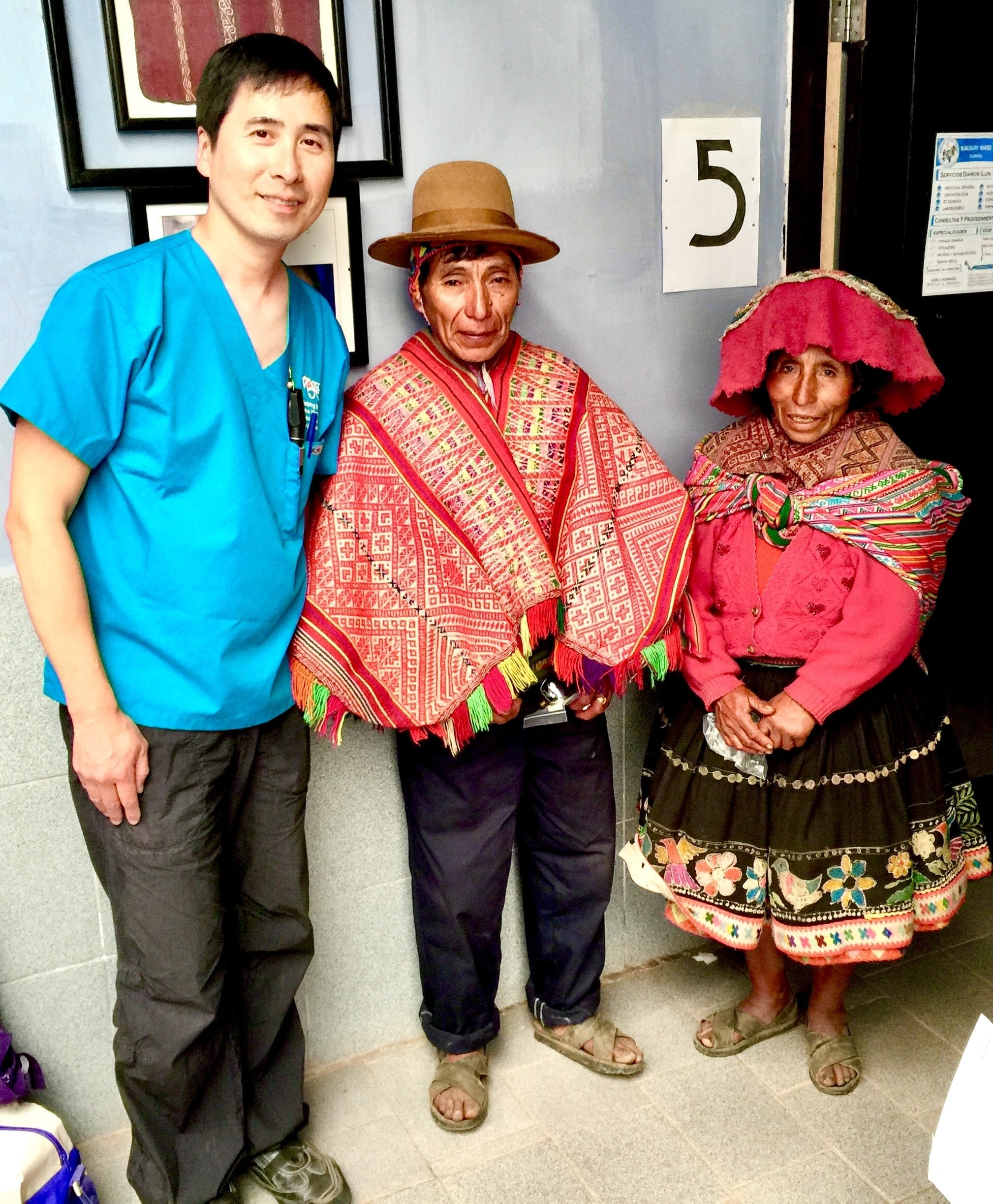 Dr. Maxwell Cheng greets a couple in Peru, who received their first pair of glasses and sunglasses from him.