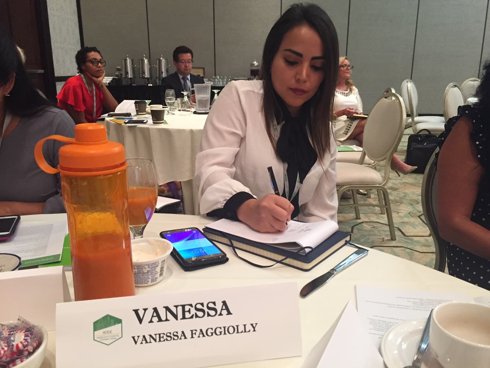 Vanessa Faggiolly sitting at a table with notes.
